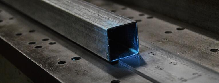Square shaped steel tube resting on a ruler