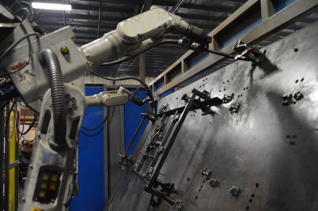 Robotic welding machines welding steel