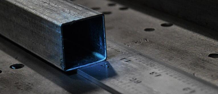 Square shaped steel tubing resting on a ruler