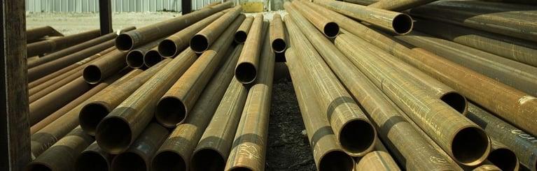 Metal_tubes_stored_in_a_yard-1024x328.jpg