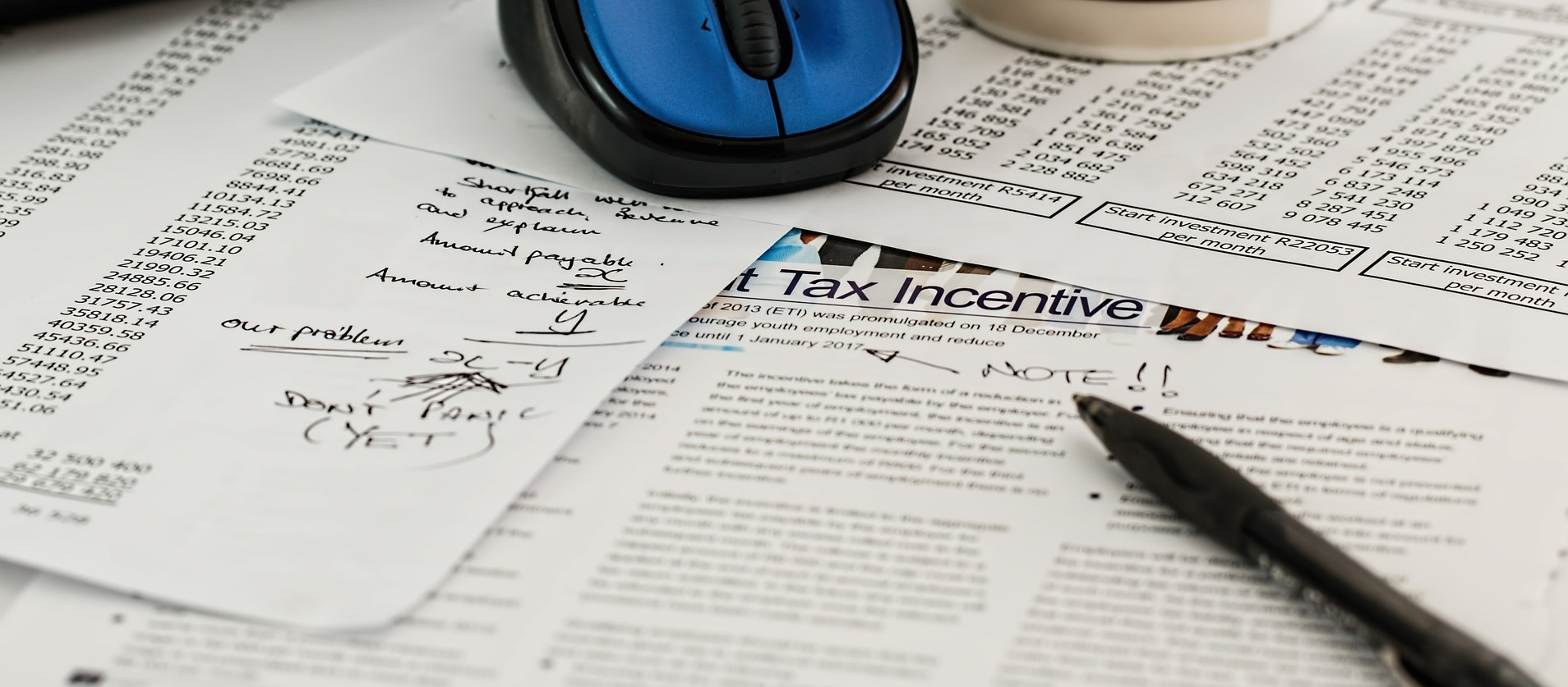 Stack of tax documents with handwritten notes