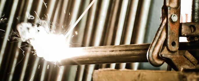 Bright sparks emitting from a welder