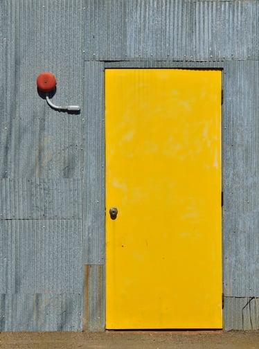 Industrial yellow exterior steel door