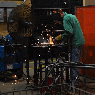 Engineer welding metal materials and creating sparks
