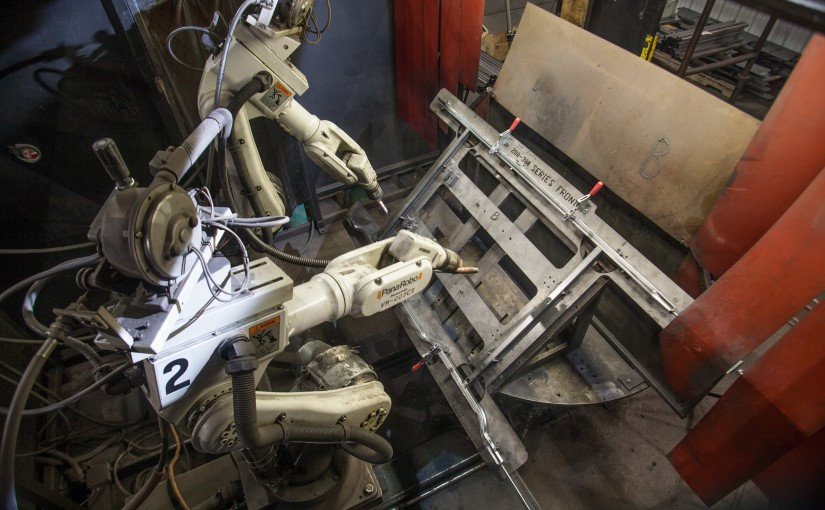 Robotic welding machine welding a bed frame