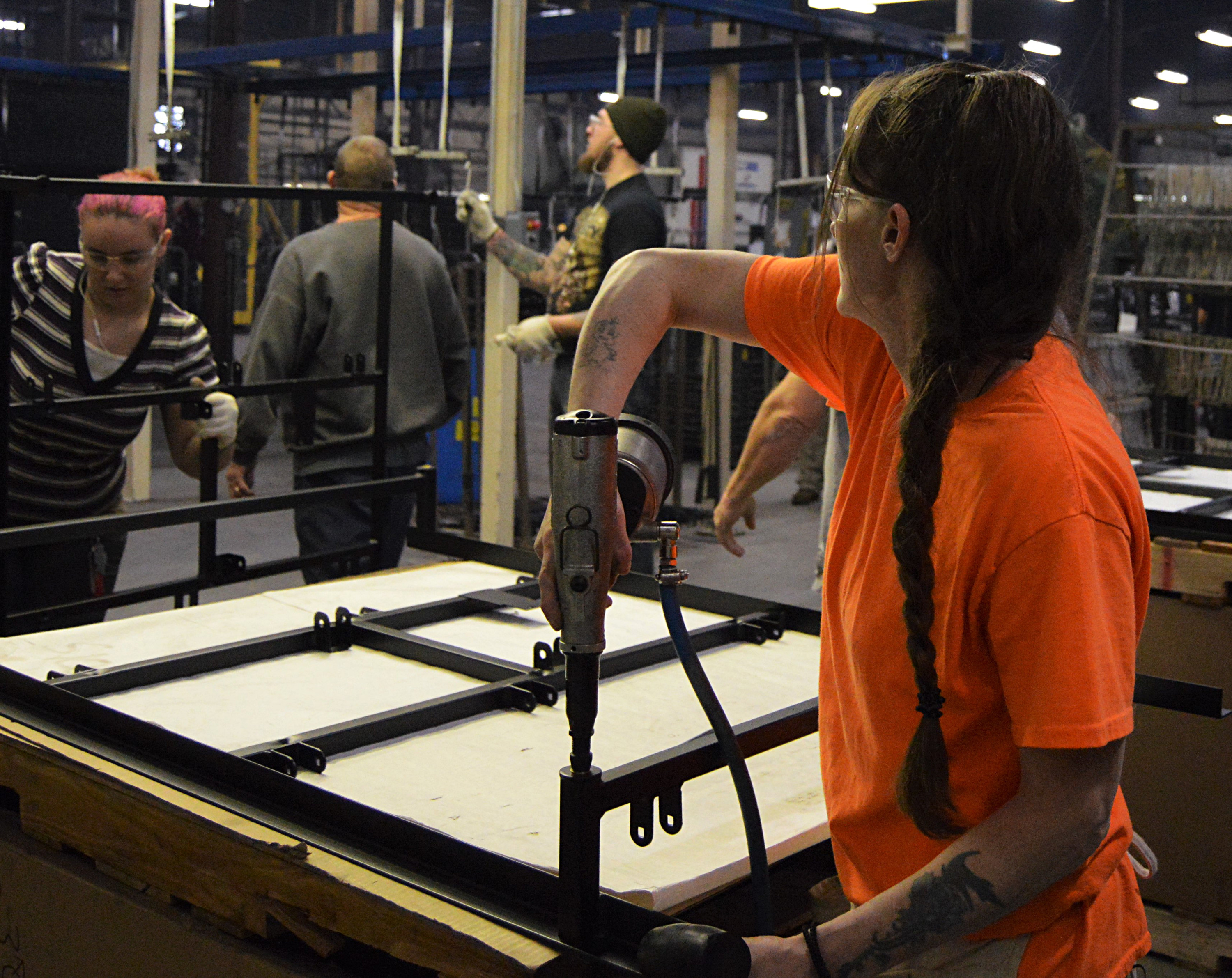 powder coating a tube on a table