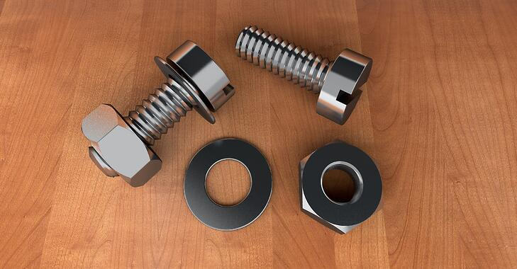 stainless steel nuts and bolts on a table